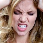woman pulling hair negative stress